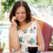 Woman chatting on her mobile phone — Stock Photo