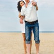 Attractive young couple on a beach — Stock Photo #11909513