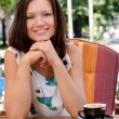Stock Photo: Smiling lady enjoying capuccino