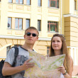 Happy tourists with a map — Stock Photo
