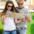 Royalty-Free Stock Photo: Young couple looking at tourist map
