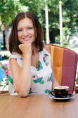 Attractive woman drinking coffee — Stock Photo