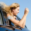Stock Photo: Woman in car taking photographs