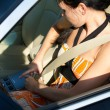 Woman tightening her safety belt — Stock Photo