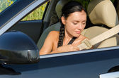 Woman putting on her seatbelt — Stock Photo