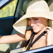 Woman driver in large sunhat — Stock Photo