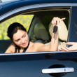 Stock Photo: Womdriver being handed her car keys