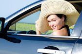 Beautiful woman in wide brimmed hat — Stock Photo