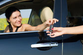 Smiling driver holding her car key — Stock Photo