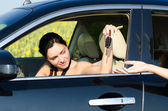 Woman driver being handed her car keys — Stock Photo