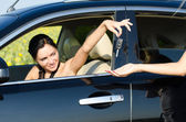 Woman handing over her car keys — Stock Photo