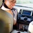 Stock Photo: Smiling female driver looking over her shoulder