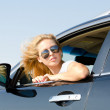 Woman looking back from the car window — Stock Photo #12240594