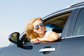 Woman looking back from the car window — Stock Photo