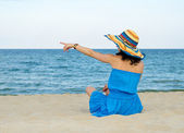 Woman pointing to the ocean — Stock Photo