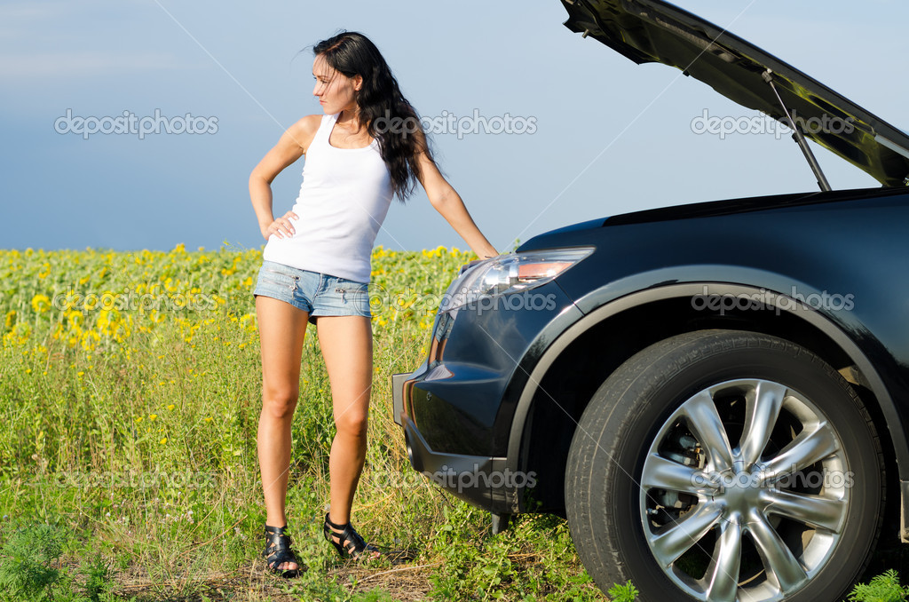 woman in shorts with broken down car stock photo ampack 12242013. Black Bedroom Furniture Sets. Home Design Ideas