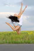 Ballerina leaping high in the air — Stock Photo