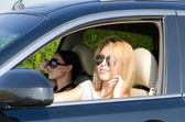 Two women in a luxury car — Stock Photo