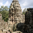 Ancient Bayon temple in Angkor , Cambodia - Stock Photo