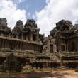 Stock Photo: Ancient Tprohn temple in Angkor, silk-cotton tree consumes ancient ruins, Cambodia