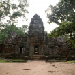 Ancient Ta prohn temple in Angkor, silk-cotton tree consumes the ancient ruins, Cambodia — Stockfoto