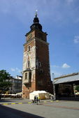 The gothic town hall tower on the main square in Krakow, Poland — Stock Photo