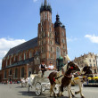 St Mary's Church,Kosciol Mariacki, at the main Market Square in Cracow, Poland - Stock Photo