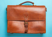 Brown Vintage leather briefcase with strap and brass buckle — Stock Photo