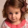 Baby girl with brown ribbon — Stock Photo #10793841