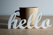 Hello in Front of Coffee Mug — Stock Photo