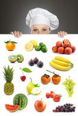 Female chef looking over fruit billboard — Stock Photo