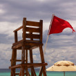 Stock Photo: Empty Lifeguard Chair and Umbrellat Beach