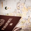 Passport & world map - Stock Photo