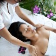 Young woman enjoying a massage day at the spa — Stock Photo #11969111