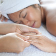 Young woman enjoying a massage day at the spa — Stock Photo
