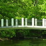 The white bridge through the small river — Stock Photo #10748309