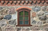Window in a stone wall — Stock Photo