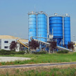 Stock Photo: High silos to contain cement and sand for building i