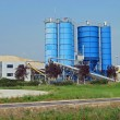 High silos to contain the cement and the sand for the building i — Stock Photo