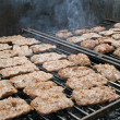 Grilled sausage grilled during a party outdoors with barbecue — Stock Photo