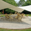 Awning to shade the chairs of the guests during a reception - Stok fotoğraf