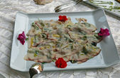 Delicate smoked sliced swordfish dressed with olive oil — Stock Photo