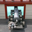 Cannon with balls in a ship of Pirates of the Caribbean - Stock Photo