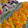 Yellow ducks ready to be fished in a merry go round of Fortune - Stock Photo