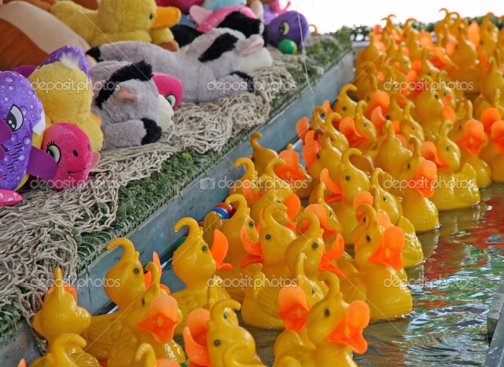 Yellow plastic ducks ready to be fished in a merry go round of Fortune — Stock Photo #11250815