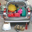 Luggage in the family car ready for the holidays — Lizenzfreies Foto