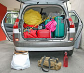 Luggage in the family car ready for the holidays — Stock Photo