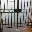 Iron gate during the high tide — Stock Photo