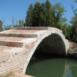 Ancient bridge of Devil on the island of Torcello near Venice — Stok fotoğraf