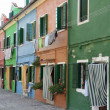 Colorful houses on the island of Burano near Venice - Stock Photo